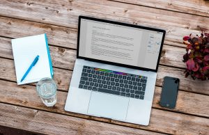 how-to-write-a-great-cover-letter-laptop-notebook-notepad